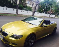 Cần bán xe BMW M6 V10 đời 2008, màu vàng, nhập khẩu, đã đi 57000 km giá 1 tỷ 590 tr tại Tp.HCM