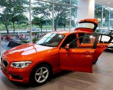 BMW 1 Series 118i 2017, màu cam. BMW Đà Nẵng bán xe BMW 118i nhập khẩu chính hãng, giá rẻ nhất giá 1 tỷ 328 tr tại Bình Định
