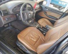 Bán ô tô chính chủ BMW 3 Series 318i AT sản xuất 2004, màu đen, giá 185tr giá 185 triệu tại Hà Tĩnh