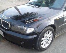 Cần bán BMW 3 Series 318i Sport đời 2004, màu đen giá 325 triệu tại Long An