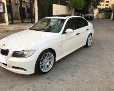 Cần bán xe BMW 320i 2007 màu trắng, nội thất kem giá 335 triệu tại Tp.HCM