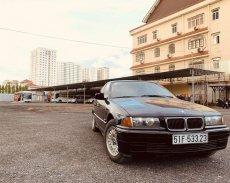 Bán BMW 320i sản xuất 1995, màu đen, nhập khẩu giá 120 triệu tại Tp.HCM