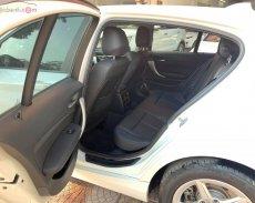 Bán BMW 1 Series 118i 2015, màu trắng, xe nhập chính hãng giá 870 triệu tại Hà Nội