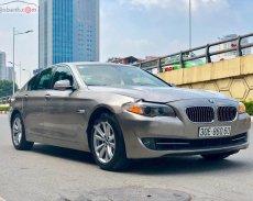 Xe BMW 5 Series 520i năm sản xuất 2012, màu vàng cát, xe nhập giá 935 triệu tại Hà Nội