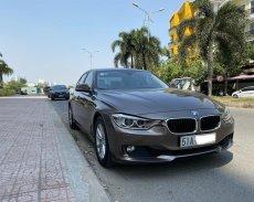 Bán xe BMW 320i 2013, màu nâu, nhập khẩu chính hãng giá 739 triệu tại Tp.HCM