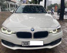 Xe BMW 3 Series 320i năm 2015 màu trắng, nhập khẩu nguyên chiếc chính chủ giá 930 triệu tại Hà Nội