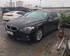 Bán ô tô BMW 320i sản xuất 2015, màu đen, form 2016 giá 945 triệu tại Hà Nội