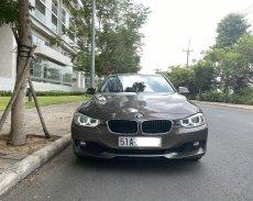 Bán xe BMW 320i năm 2013, nhập khẩu nguyên chiếc giá 728 triệu tại Tp.HCM